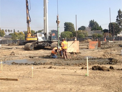 Newcomb Academy job site drill concrete pilings