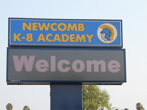 Newcomb Academy marquee with welcome