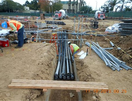construction workers laying down pipe