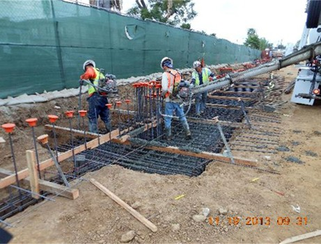construction workers pouring concrete