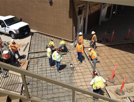 aerial view of construction workers looking at walkway
