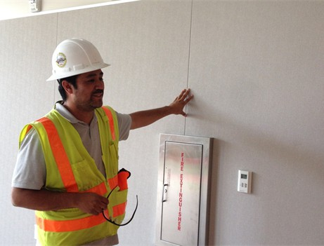 construction worker touching finished wall