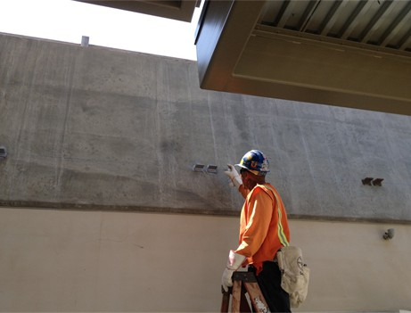 construction worker pointing at finished wall