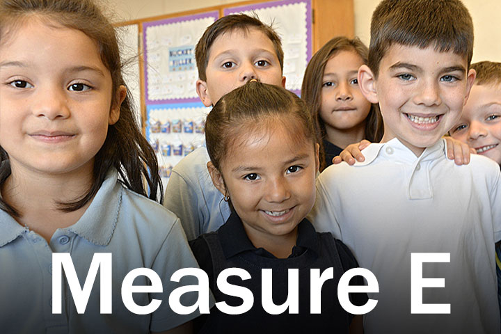 elementary LBUSD students in uniform who benefit from Measure E school bond