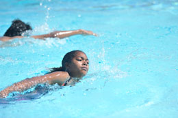 Girl swimming in Cabrillo High School pool
