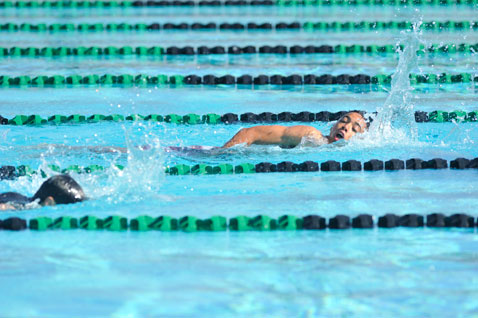 Two swimmers doing laps in Cabrillo High School pool