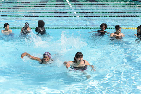 Group of kids swimming in Cabrillo High School pool