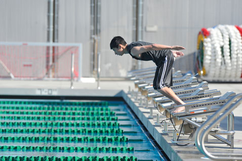 Boy diving into Cabrillo High School pool