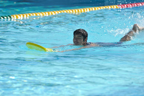 Boy swimming in Cabrillo High School pool